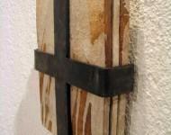 STORIE DI UN UOMO, terracotta smaltata e ferro, cm 20x30x4, 2004 (collezione privata)